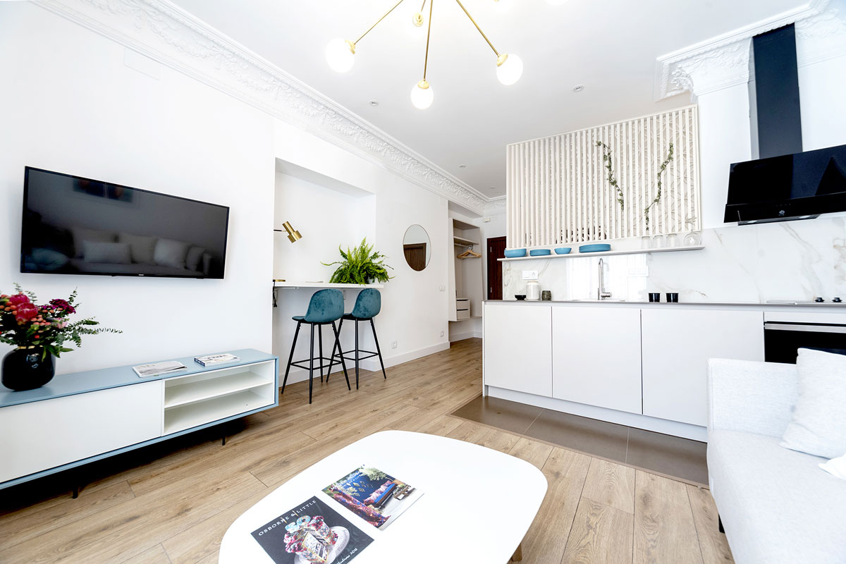 White Santos kitchen that opens into the living-dining room