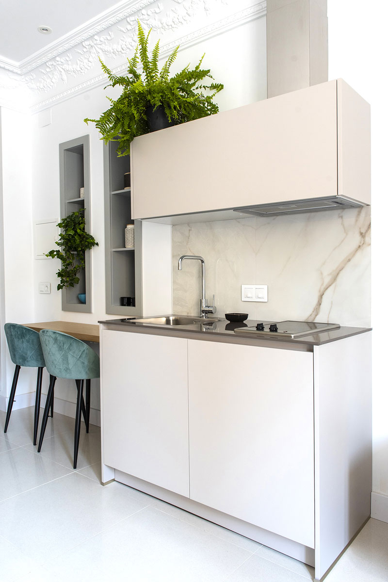 White and functional open-plan Santos kitchen