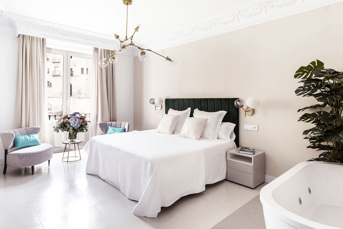 Bright bedroom in light colours and green