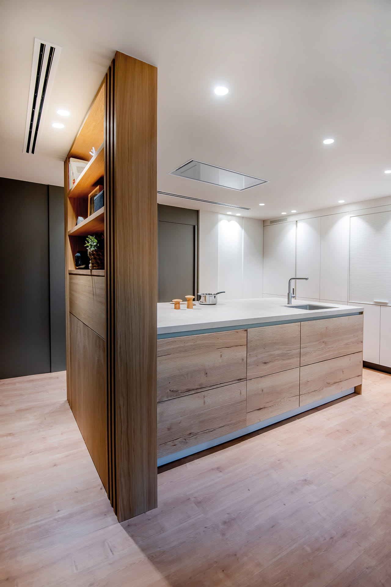 Open-plan kitchen with peninsula and wood