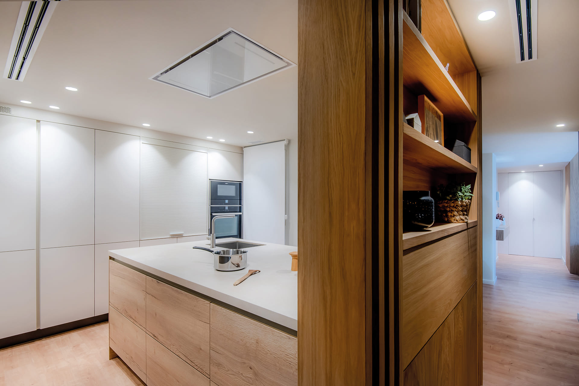 Kitchen with wooden divider cabinet