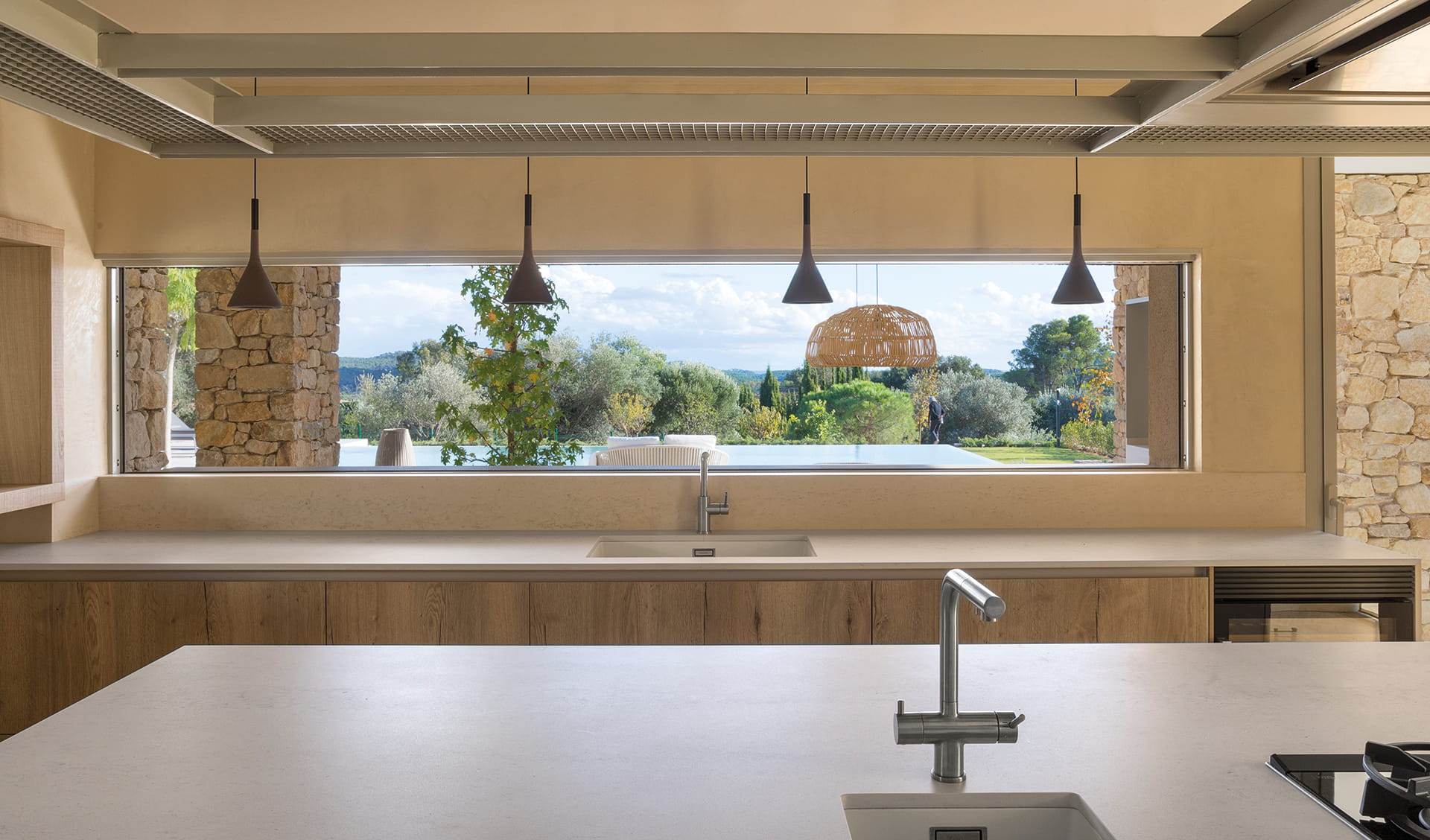 Kitchen worktop and island in light colours and wood