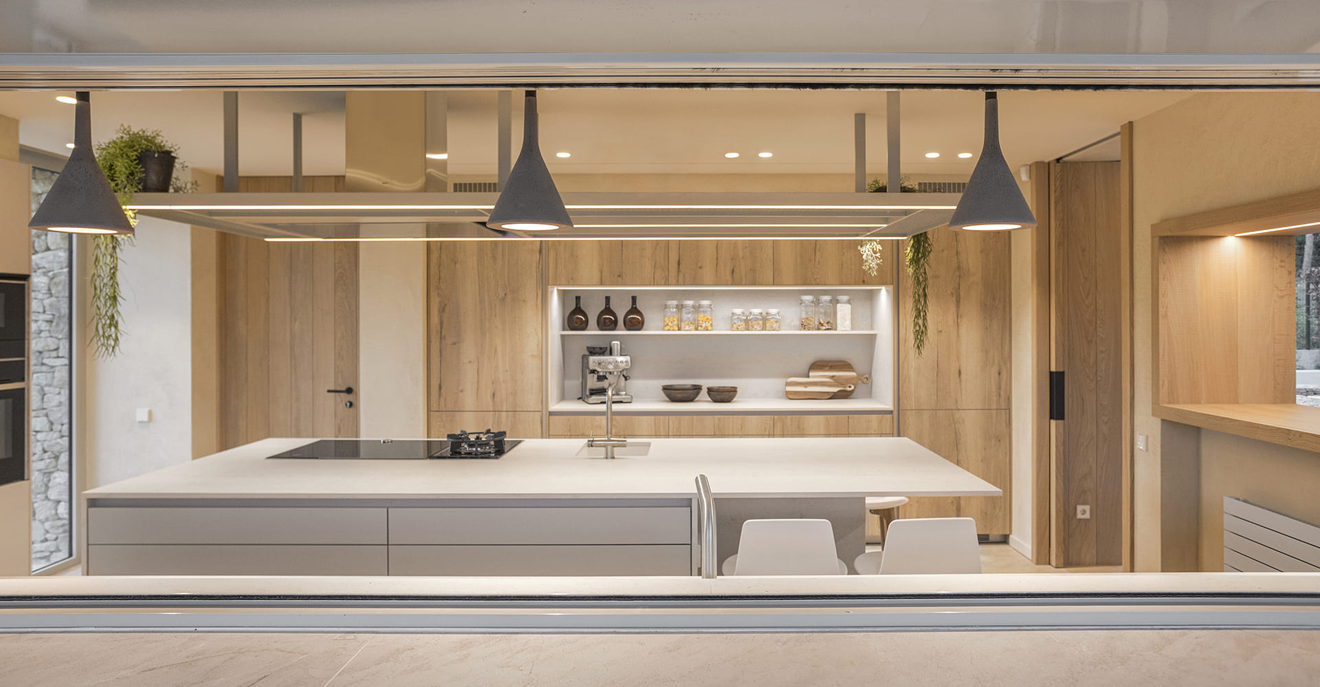Santos kitchen with island and an oak wood finish in light colours
