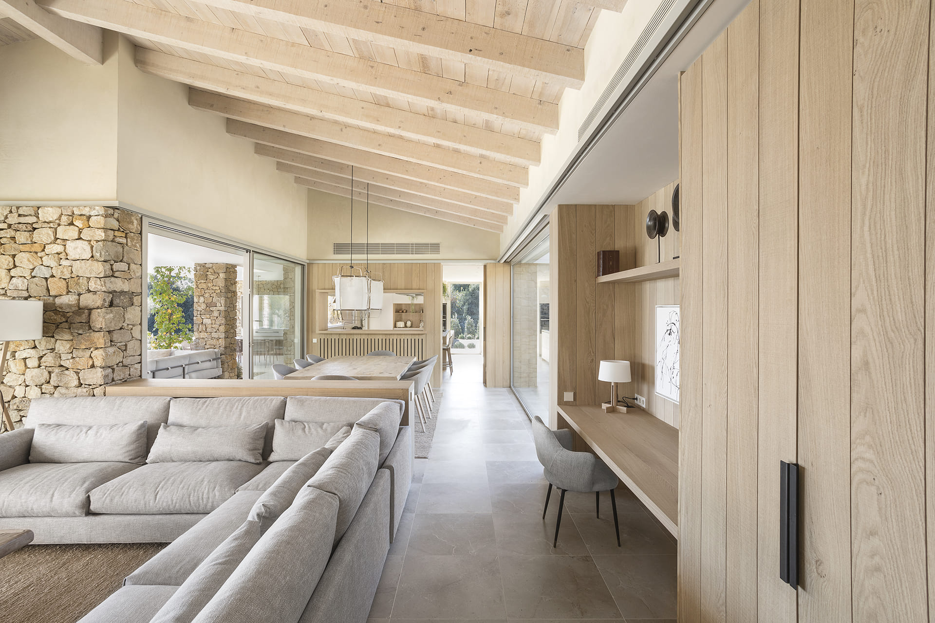 Open-plan living area, kitchen and dining area with large windows