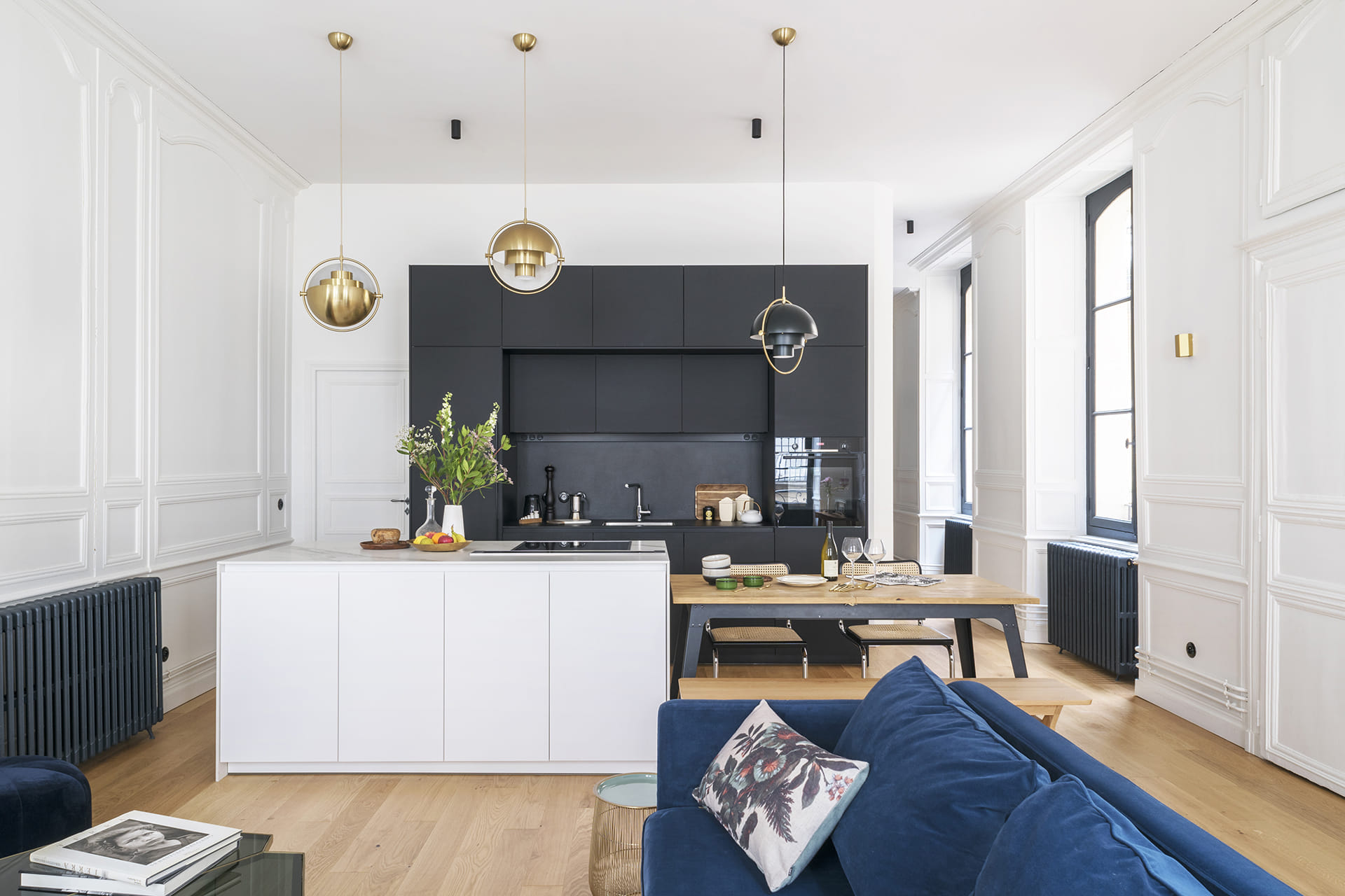 Santos black and white kitchen with island which opens out to the living-dining area