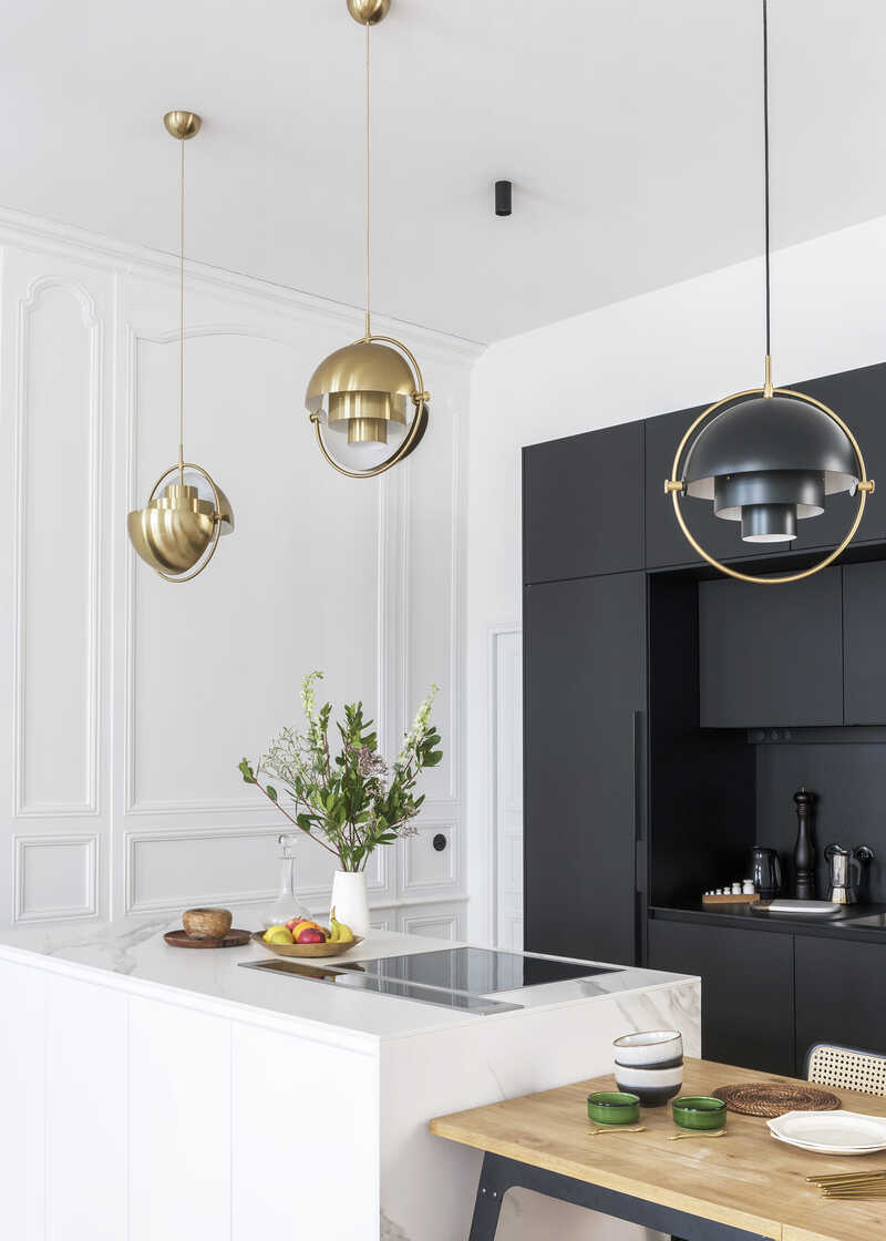 Santos black kitchen with white island and lamps